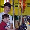 Debby High — For Montgomery Media<br /> Brothers Noah and Clayton Garber, of Quakertown, follow their mom's childhood tradition of riding the Perkasie Carousel.