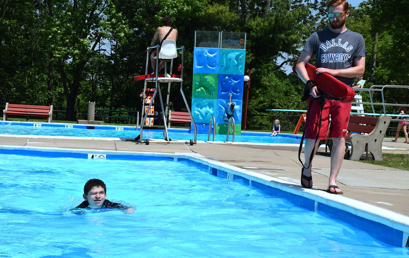 Debby High — For Montgomery Media<br /> Ryan Rambo, manager of Holiday House, watches over Jonny Sarro as he works to pass his swimming test.