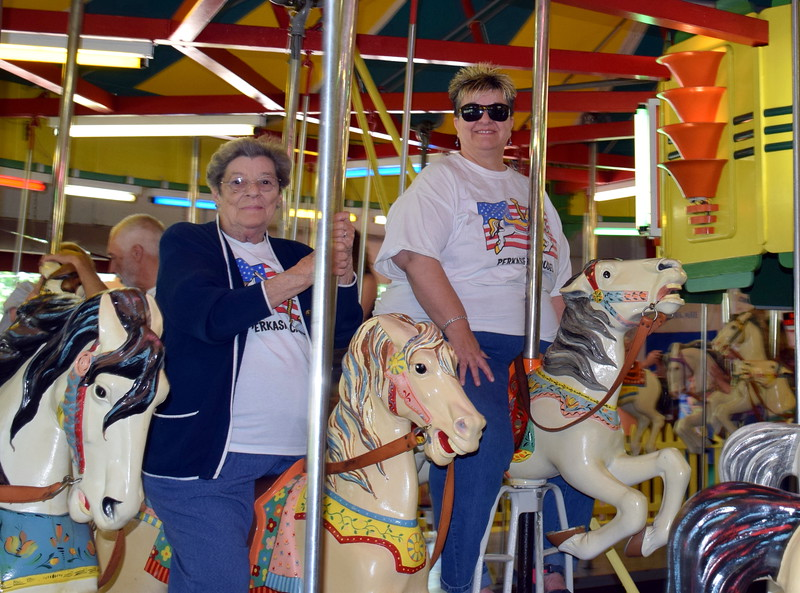 Debby High — For Montgomery Media<br /> Joyce Mayer and her daughter, Lore Mayer, enjoy a carousel ride on Memorial Day.