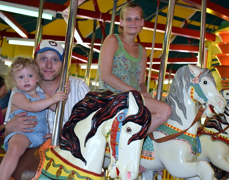 Debby High — For Montgomery Media<br /> Christopher Dwyer held his daughter, Zybenicka, with Mandy Beer, right, take a ride at the Perkasie Carousel on Memorial Day.