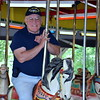 Debby High — For Montgomery Media<br /> Doug Kramer, of Perkasie, enjoys a free ride on the Perkasie Carousel, which were offered to veterans on Memorial Day.