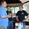 Debby High — For Montgomery Media<br /> Sean Gresh, left, Carousel Chairman Bert Coffman and Perkasie Historical Society President Charles Baum operate the Perkasie Carousel.