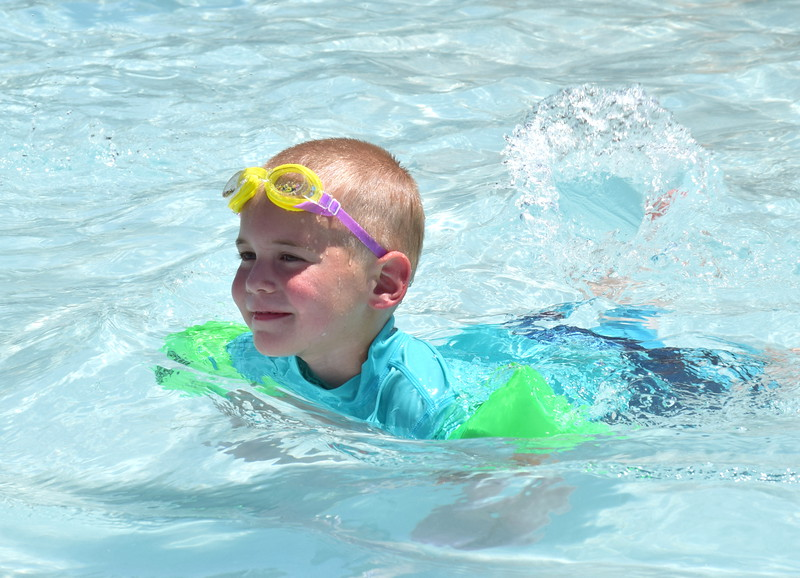 Debby High — For Montgomery Media<br /> Benjamin Brady, 4, enjoys a swim in the pool at Menlo Aquatics Center on opening day.