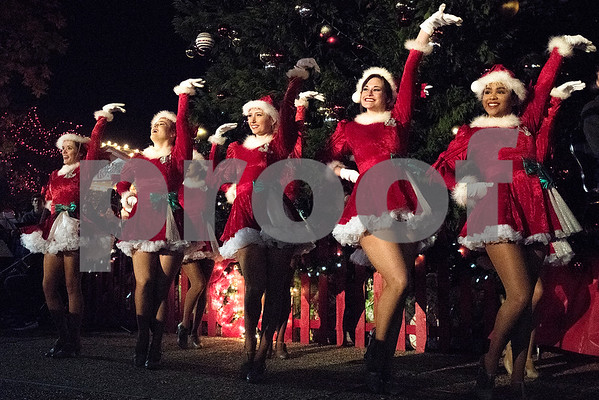 The Tyler Junior College Apache Belles perform at the Tyler Christmas tree lighting ceremony in Tyler, Texas, on Thursday, Nov. 30, 2017. Thousands came to watch the parade and see the Christmas tree light up for the first time on T.B. Butler Fountain Plaza. (Chelsea Purgahn/Tyler Morning Telegraph)
