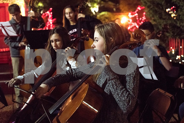 The East Texas Youth Symphony performs at the Tyler Christmas tree lighting ceremony in Tyler, Texas, on Thursday, Nov. 30, 2017. Thousands came to watch the parade and see the Christmas tree light up for the first time on T.B. Butler Fountain Plaza. (Chelsea Purgahn/Tyler Morning Telegraph)