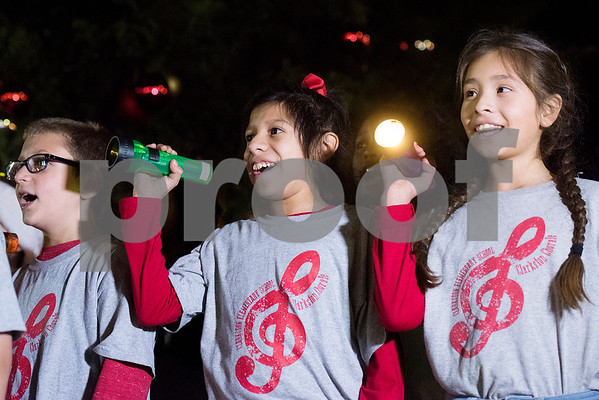 Clarkston Elementary School students perform at the Tyler Christmas tree lighting ceremony in Tyler, Texas, on Thursday, Nov. 30, 2017. Thousands came to watch the parade and see the Christmas tree light up for the first time on T.B. Butler Fountain Plaza. (Chelsea Purgahn/Tyler Morning Telegraph)