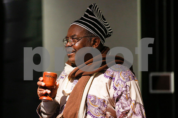 Patrick Tume speaks during a Kwanzaa celebration at the Tyler Public Library in Tyler, Texas, on Tuesday, Dec. 26, 2017. The African-American Cultural Events Committee will host an event each night of Kwanzaa. (Chelsea Purgahn/Tyler Morning Telegraph)