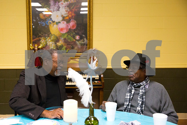 Steve Oliver and Richard Staples chat during a New Year's party at the Tyler Senior Center in Tyler, Texas, on Friday, Dec. 29, 2017. Guests enjoyed a dinner made up of traditional New Year's foods and danced to live music. (Chelsea Purgahn/Tyler Morning Telegraph)