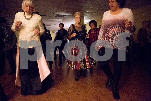 People dance during a New Year's party at the Tyler Senior Center in Tyler, Texas, on Friday, Dec. 29, 2017. Guests enjoyed a dinner made up of traditional New Year's foods and danced to live music. (Chelsea Purgahn/Tyler Morning Telegraph)