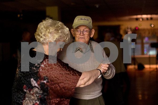 Wanda Allen and Phil Burdick dance during a New Year's party at the Tyler Senior Center in Tyler, Texas, on Friday, Dec. 29, 2017. Guests enjoyed a dinner made up of traditional New Year's foods and danced to live music. (Chelsea Purgahn/Tyler Morning Telegraph)