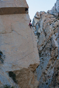 Me on the stunning arete of Eclipsed 5.11d, Pine Creek.