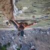 Pam crushing a 5.10d in Pine Creek