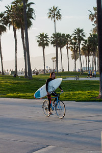 Surfer Chick heading home Venice beach style.