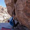 Pam bouldering the V5 version of sex magician. JTree