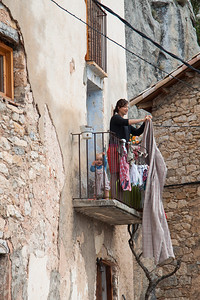 Ella and Owen on their front balcony, doing the spanish thing and hanging their washing over it