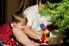 Aidan and Carolyn decorating one of our 5 Christmas trees.