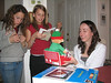Louie's daughter Jordan (center) compares presents with her friend and with Danny's daughter Lindsey (right).
