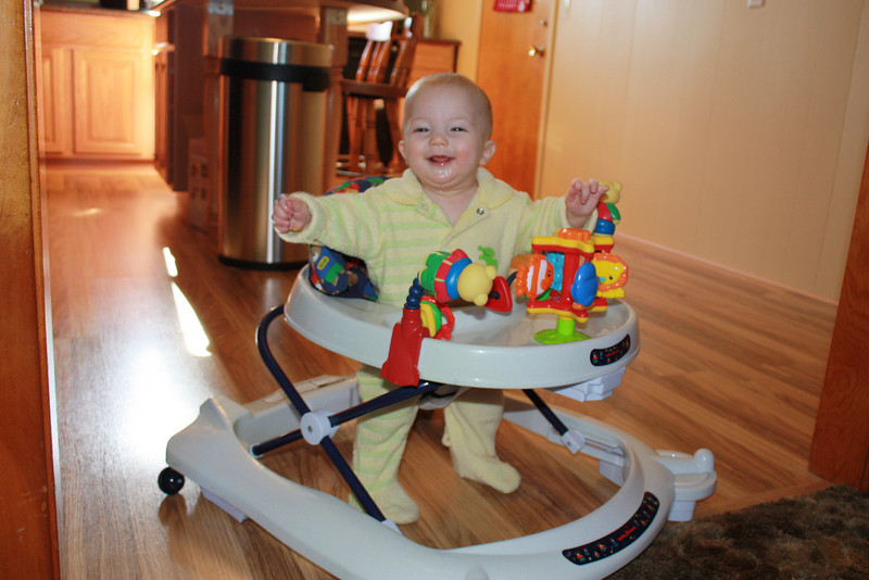 Elisha loaned us Isaac's old walker... needless to say it's a big hit