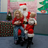 Bev and Quinn sit on Santa's lap