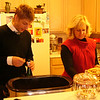 Our resident Sommelier Level II, Christopher, prepares the wine as Linda loads the white Turkey meat for serving