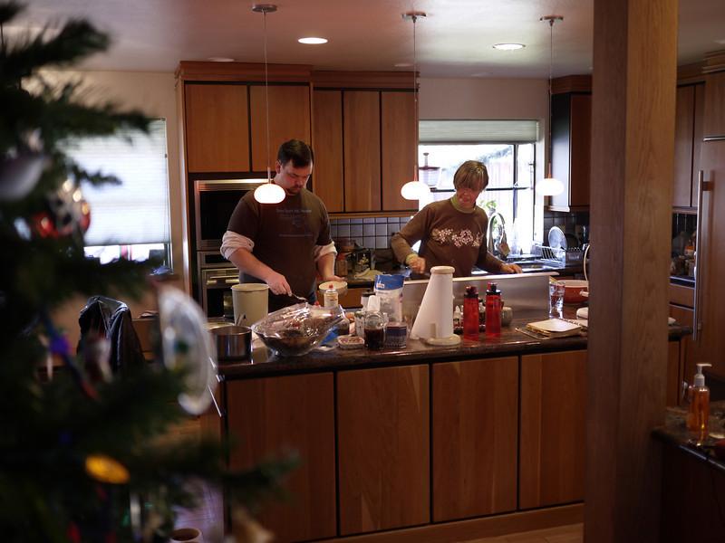 Erik and Mom work at pie making.