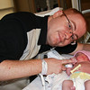 Baby Moyra and proud daddy Christopher.
