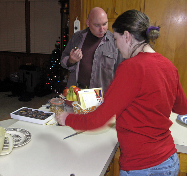 Dec 20.  Gary has chosen his candy and Kimberly looks for the piece she wants.