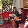 Ann opens gifts with her daughter-in-law, Carrie.
