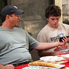 Ann's son Brook and her grandson Devon compare cell phones.