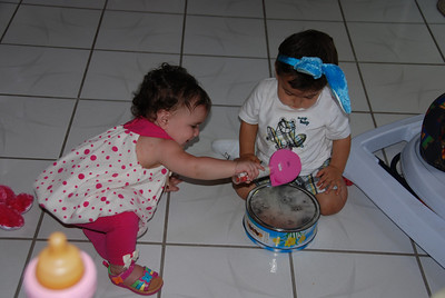 Izabella shows Bunny Boy Jaden how to improvise a drum....