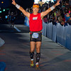 Tom finishing his second Ironman. With an achilies tendon problem that forced him to walk, he still finished with a smile. - 2012 Coeur d'Alene Ironman