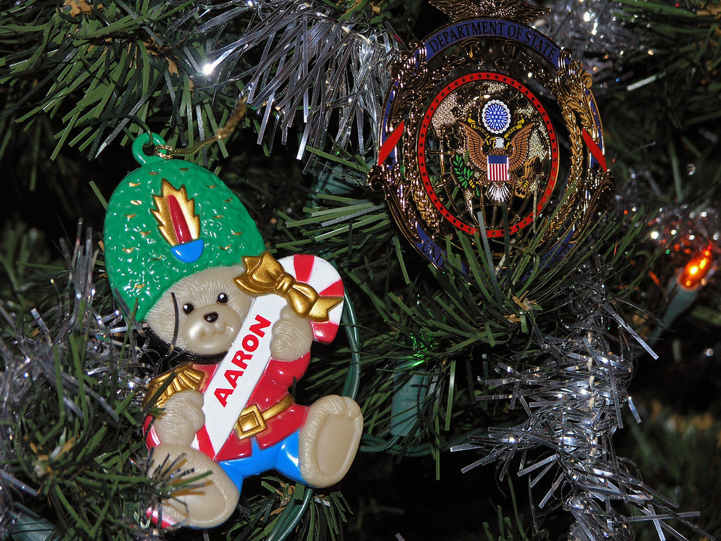 Dec 24.  This closeup of one decoration is enough to let you know that all seven grandchildren have this kind of decoration (either a bear or a bell) with his name on it, and all seven are on the tree.  I chose to use this one as the sample because next to it is another decoration that has special meaning.