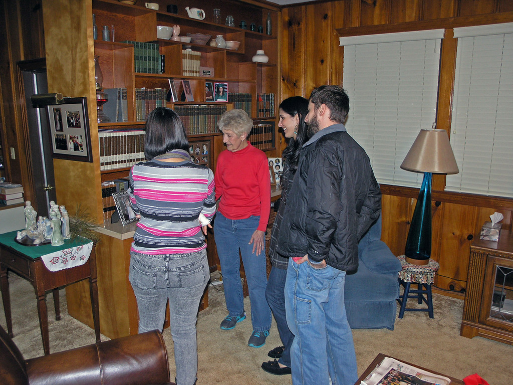 Dec 22.  Cindy, Gmom, Shirene, and Dustin admire the wedding picture of Shirene and Dustin.