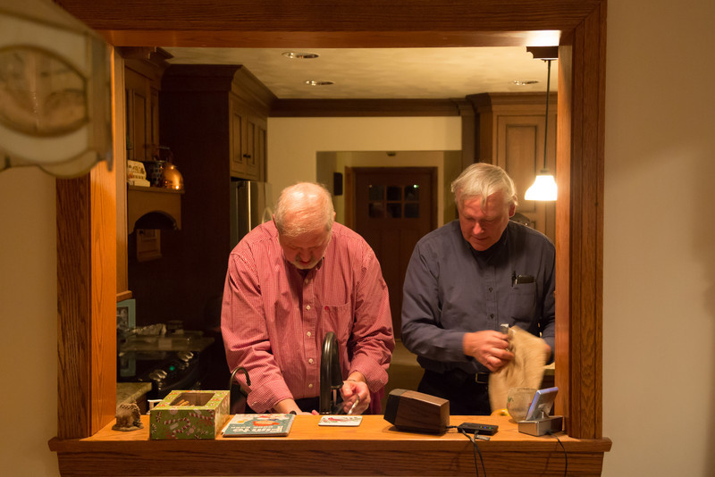 """Dad & Uncle Don working on some dishes. """"Where does this thing get put away"""" is the most commonly used phrase."""