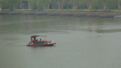October 2012. A family takes a quiet Sunday drive... ON A LAKE. In China. Next to the hotel Matt stays at. What a great world we live in.