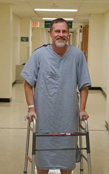 March 2012. A few days after surgery, he was up and shuffling, perhaps for when he really needs a walker!