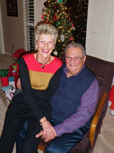 Linda and Pete pose for a Christmas card photo