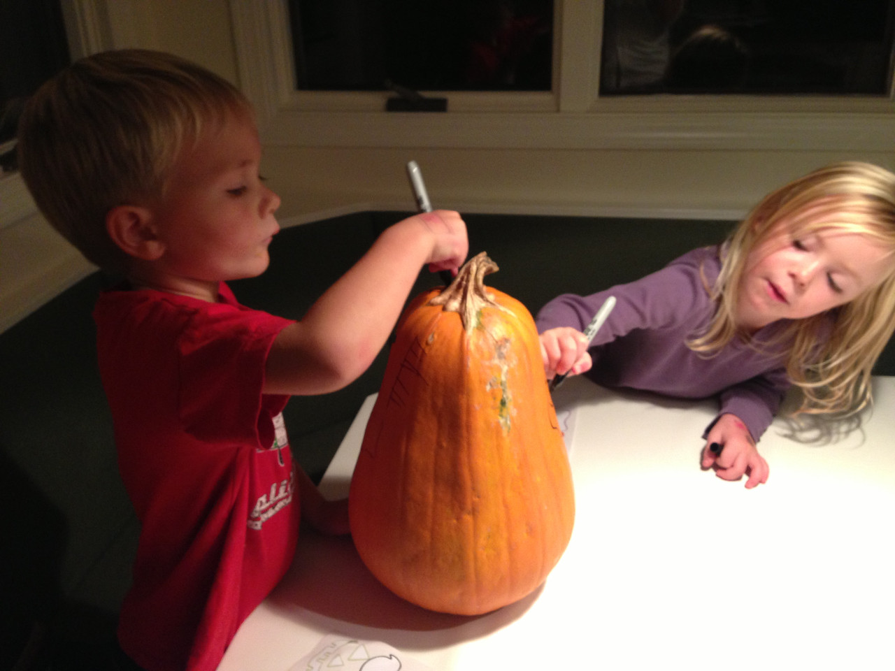 Kirian and Lily decorate the pumpkin