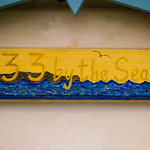Photo taken of the signs on the huts at the edge of Westward Ho! beach. Each hut sign is designed by the owner - such fun