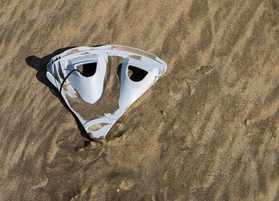 Sad face on the beach