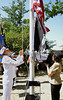 Bob Raines--Montgomery Media<br /> AMEAN Kurt Faras and PO2 Wanda Taylor, both U.S. Navy, raise the American and MIA/POW flags at the Memorial Day ceremony in Veterans Park, Wyndmoor read the names on the Springfield Honor Roll May 25, 2015.