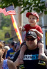 Bob Raines--Montgomery Media<br /> Andrew Carnavil waves his flag atop his dad, Ryan during the Wyndmoor Memorial Day Parade May 25, 2015.