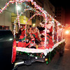 John P. Cleary |  The Herald Bulletin<br /> Santa and his elfs ride down Meridian Street in their brightly colored wagon.