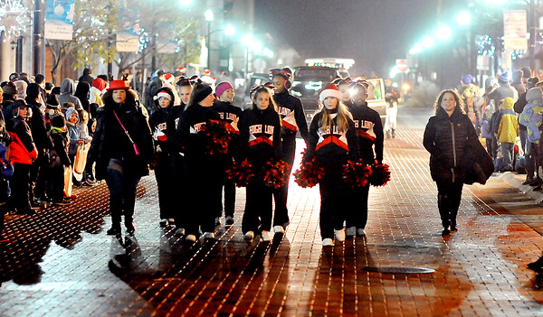 John P. Cleary |  The Herald Bulletin<br /> The Highland Middle School Cheerleaders step off down Meridian Street during the Christmas Parade.