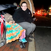 John P. Cleary |  The Herald Bulletin<br /> Sophie Mechem, 3, wants nothing to do with watching the Christmas Parade as her mother Brittanie Mechem tries to get her attention as Sophie keeps buried in her blanket trying to stay warm.