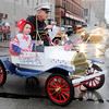 Don Knight | The Herald Bulletin<br /> A patriotic go kart styled after a Model T participates in Anderson's Independence Parade on Sunday. The fireworks and concerts were canceled due to the rain but the parade went on as scheduled.