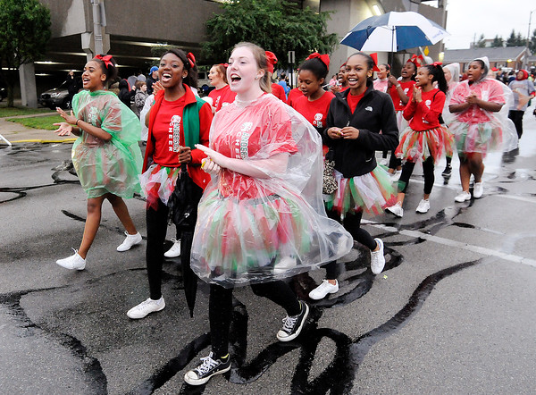 Don Knight | The Herald Bulletin<br /> The Anderson High School Cheerleaders march in Anderson's Independence Parade on Sunday. A large crowd turned out despite the rain which did come to an end shortly after the parade started.