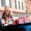 Don Knight | The Herald Bulletin<br /> MaKenzie McGuire rides in the Christmas in Pendleton parade on Saturday.