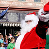 Don Knight | The Herald Bulletin<br /> Santa waves to the crowd as he rides in the Christmas in Pendleton parade on Saturday.