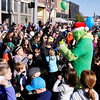 "Don Knight | The Herald Bulletin<br /> Kids toss their ""snow balls"" at the Grinch during Christmas in Pendleton on Saturday. Styrofoam craft balls are handed out at the end of the parade each year for a snow ball fight."